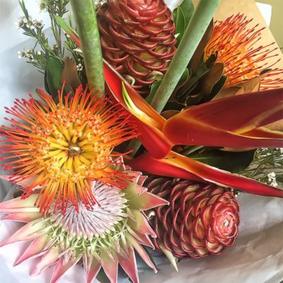 brown-beehive-gingers-red-heleconia-crabsclaw-orange-leucosprurmums-king-protea-wax-flower-bouquet
