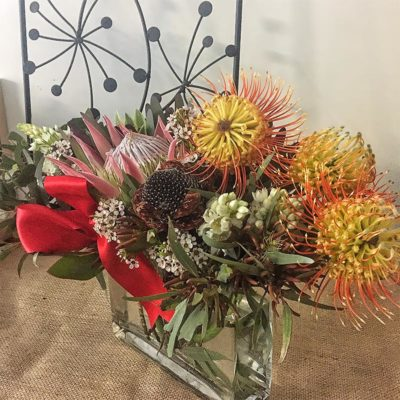 hero-king-protea-surrounded-leptospermums-gum-wax-flower-banksia-seed-pod