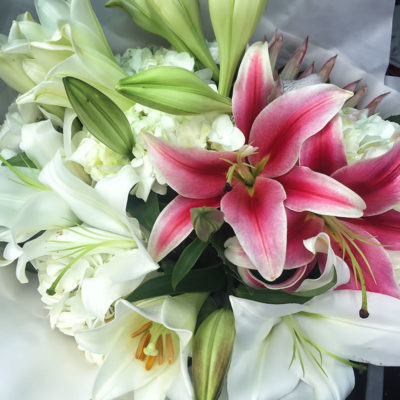 november-lillies-hydrangea-and-oriental-lillies-bouquet-wrapped-in-white-tissue-and-brown-kraft-paper