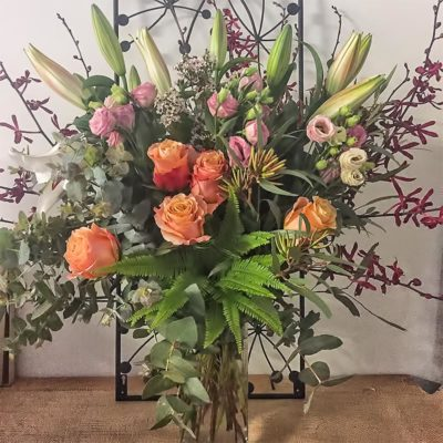 oriental-lillies-red-orchids-lisianthus-gum-leave-nuts-umbrella-fern