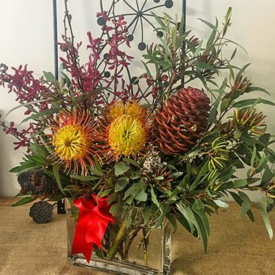 tropical-mixed-native-selection-red-orchids-leucospermums-beehive-brown-ginger-gum-leaves-banksia-seed-pod